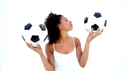 Pretty Girl In White Holding Footballs stock footage