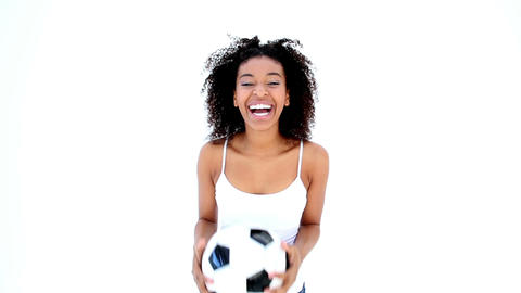 Pretty Girl In White Holding Football stock footage