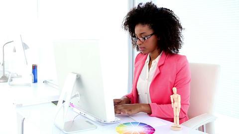 Pretty designer working at her desk Footage