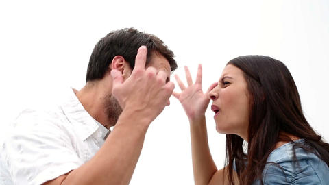 Angry young couple shouting at each other Footage