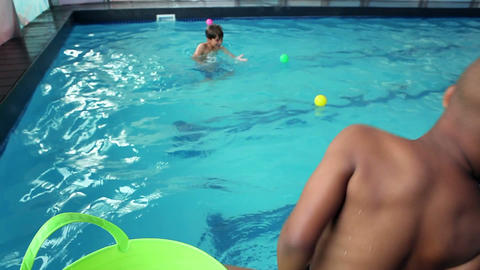 Cute little boys playing in the pool Footage
