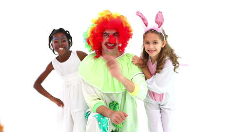 Cute children posing with funny clown Footage
