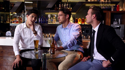 Male Friends Enjoying A Beer Together stock footage