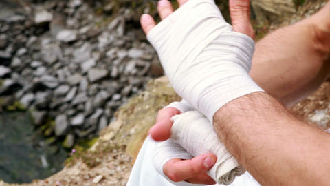 Fit man wrapping hands in bandage Footage