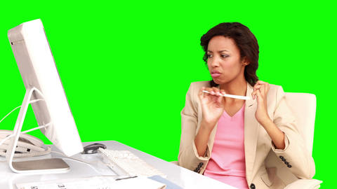Businesswoman filing her nails at her desk Footage