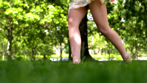 Womans feet walking on grass Footage