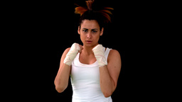 Tough boxing girl punching to camera Live Action