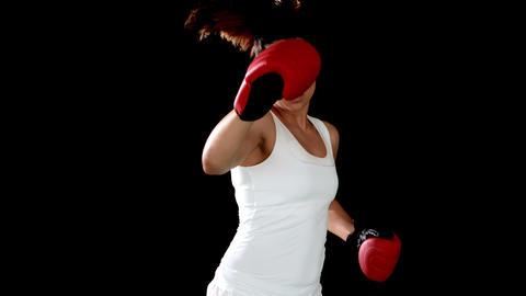 Brunette punching in boxing gloves ライブ動画