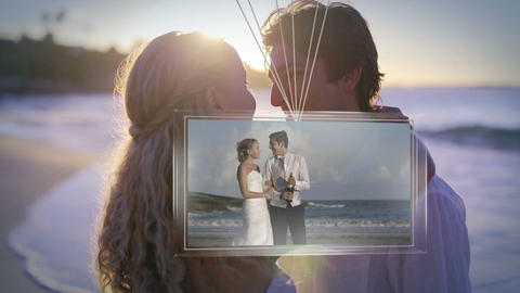 Balloons carrying screen showing newlywed couple on beach Animation