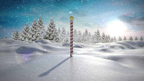 Snow falling on snowy landscape with north pole Animation