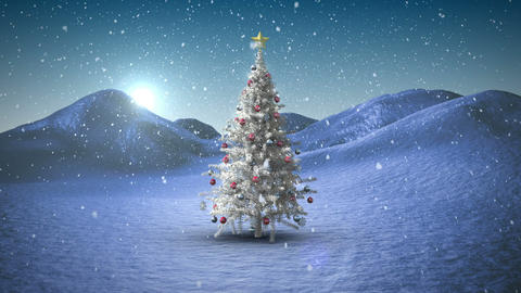 Snow falling on christmas tree in snowy landscape Animation