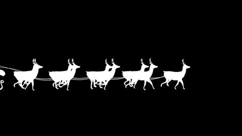 Santa and his sleigh flying against black backgrou Footage