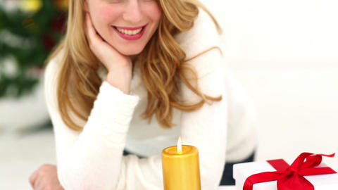 Festive blonde with christmas candle Footage