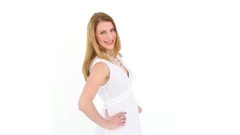 Happy blonde posing in white dress Footage