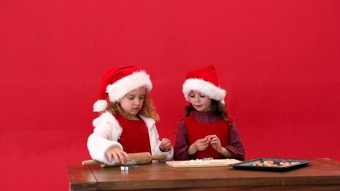Cute festive sisters making christmas cookies Footage