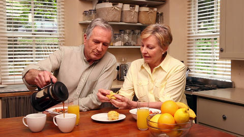Older Happy Couple Having Breakfast stock footage