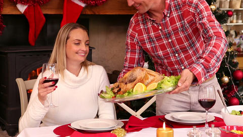 Couple having christmas dinner together Live Action