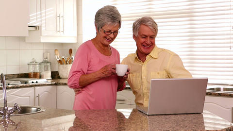 Senior Couple Using Laptop Together stock footage