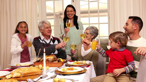 Three generation family having christmas dinner together Live Action