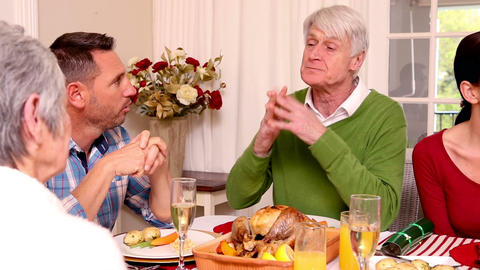Three Generation Family Having Christmas Dinner To stock footage