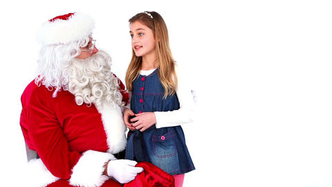 Little girl telling santa what she wants for christmas Footage
