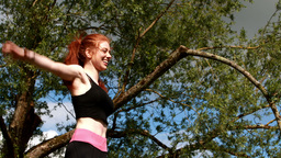 Fit redhead jumping and cheering Footage