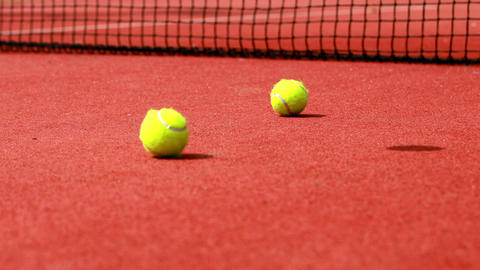Tennis Balls Hitting The Court stock footage