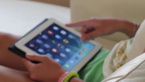 Girl Using an iPad Footage