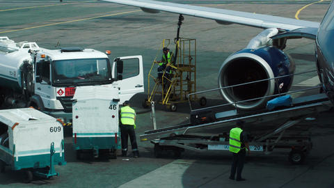 Workers Getting Luggage From Airplane stock footage