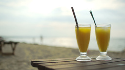 Two Cocktails On Wooden Table By The Sea Footage