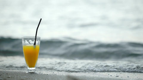 Glass Of Cocktail On Beach And Waves Washing Shore stock footage