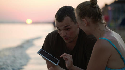 Man And Woman With Tablet Pc On The Beach Footage