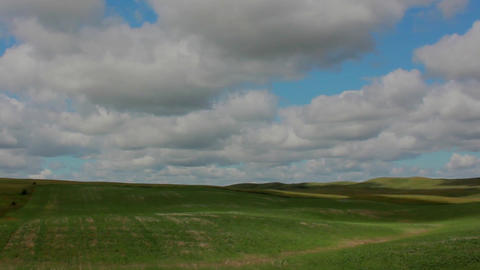 Clouds HIlls Shadows Timelapse stock footage