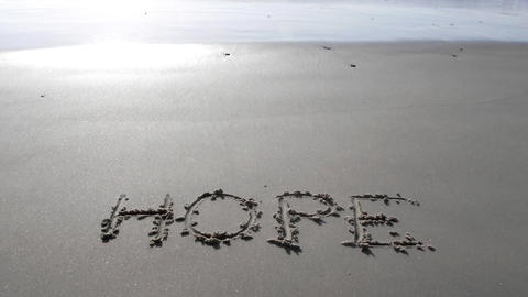 hope written on sand sunset waves beach romantic romance... Stock Video Footage