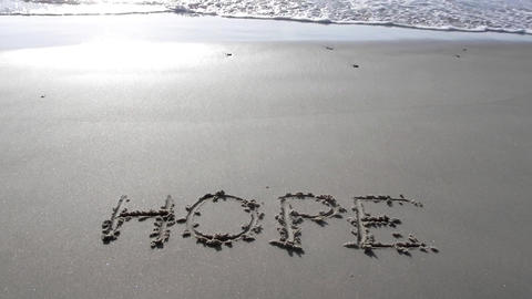 hope written on sand sunset waves beach romantic romance background Footage