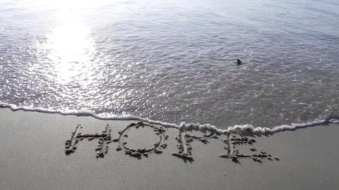 hope written on sand sunset waves beach romantic romance... Stock Video Footage