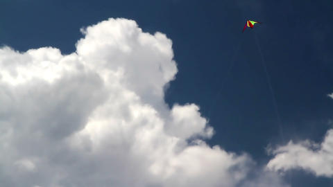 Bright white kite in the clouds Footage