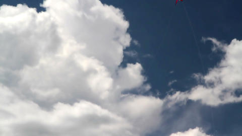 Bright white kite in the clouds Stock Video Footage