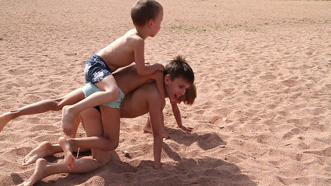 Children playing on the beach Stock Video Footage