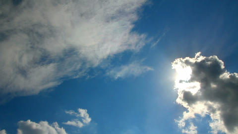 clouds and sun on blue sky Stock Video Footage