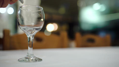 Pouring white wine into glass in restaurant Footage