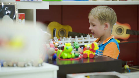 Boy Playing With Toys In Game Room stock footage