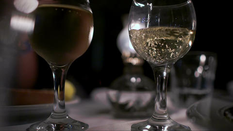 Pouring wine into empty glass in restaurant Footage
