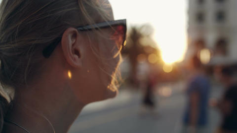 Woman in sunglasses looking into distance during s Footage