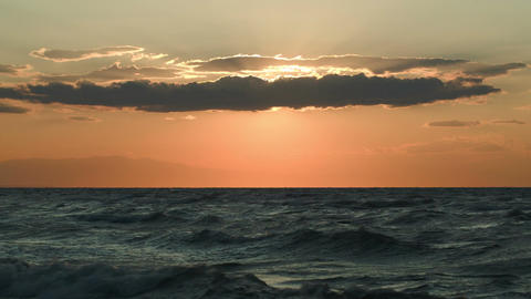 Rough sea and evening sun hidden with cloud Footage