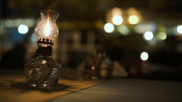 Lit antique oil lamp on table in cafe Footage