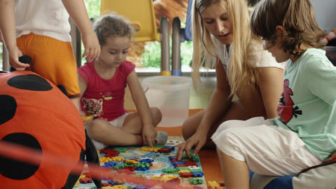 Learning game with tutor in nursery Footage