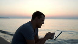 Man using tablet computer on the beach Footage