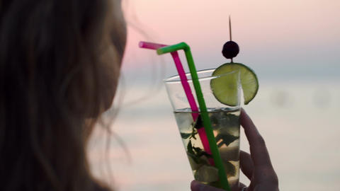 Woman drinking mojito with a straw Footage