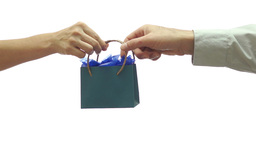 Giving Away A Small Blue Gift Bag stock footage